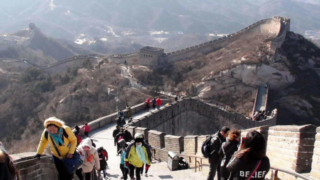 People Walking Up And Down Steps Of Great Wall Of China Badaling Section